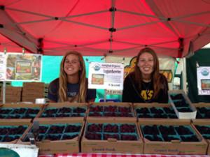 girls selling berries